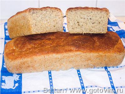 Формовой хлеб из пшеничной муки и овсяных хлопьев. Фотография рецепта