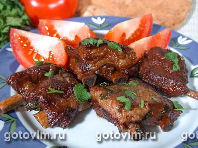 Свиные ребрышки в вине с томатным соусом